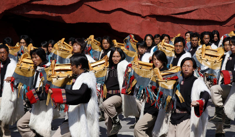 Folk dance. Outdoor performance of Chinese folk dance entitled Impression Lijiang given at the foot of Yulong (Jade Dragon Snow) Mountain in southwestern China stock image