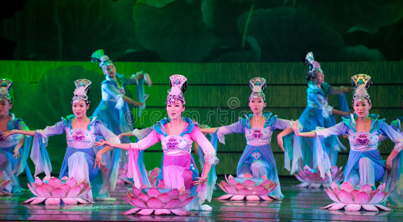 Folk Dance: Lotus. In May 7, 2010, a reflection of Jiangxi original ecological humanities landscape of large style song and dance the wind in Jiangxi Art Theatre stock photography