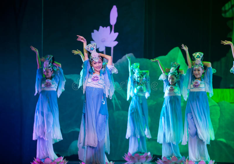 Folk Dance: Lotus. In May 7, 2010, a reflection of Jiangxi original ecological humanities landscape of large style song and dance the wind in Jiangxi Art Theatre royalty free stock image