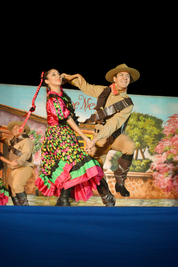 Folk dancers. Couple of dancers performing a folklorist mexican dance