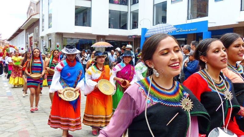 Folk dancers represent variety of Ecuadorian culture stock image