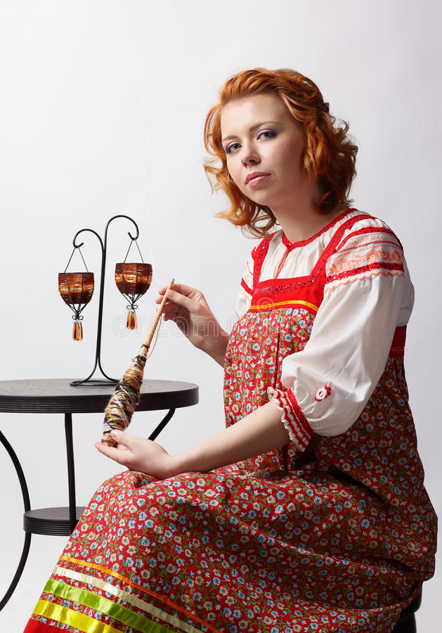 Folk girl with distaff stock images