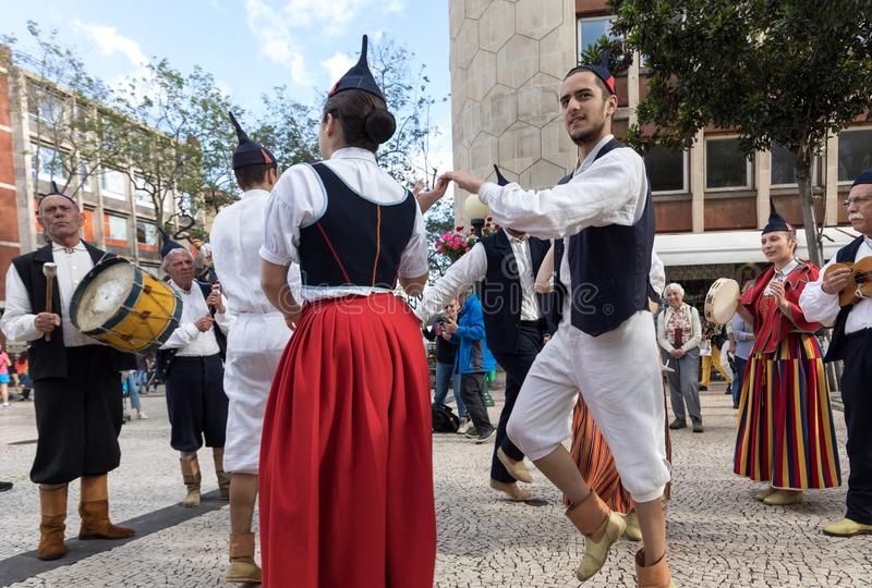 Folk musicians and dancers performing on the Avenida Arriaga in Funchal on the Madeira Island, Portugal. royalty free stock photography