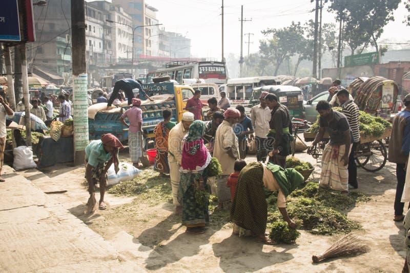Folk som säljer örter i Chittagong, Bangladesh fotografering för bildbyråer