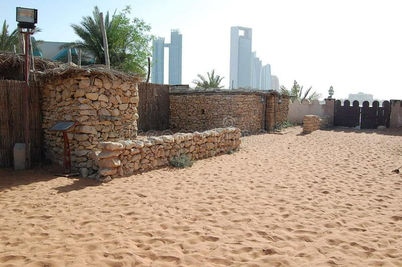 Folk Village in Dubai on the background of ultra-modern skyscrapers, United Arab Emirates. stock photography