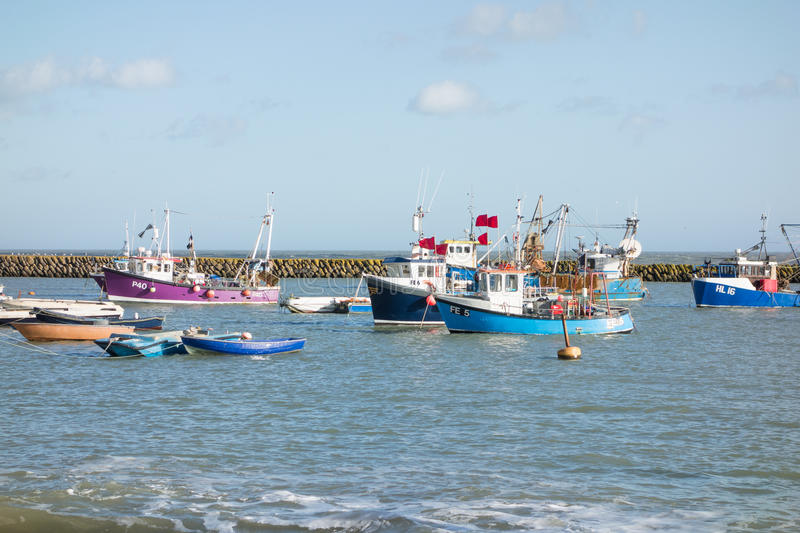 Folkestone harbour, Kent, UK. The outer harbour at Folkestone, Kent, UK. Folkestone still has an active and thriving fishing industry, all of the boats on this stock photo