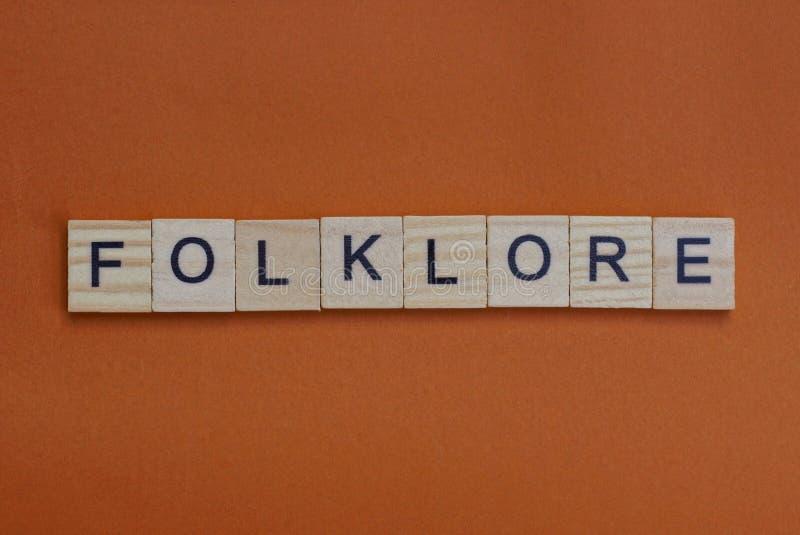 Folklore de palabras grises de pequeñas letras de madera foto de archivo libre de regalías
