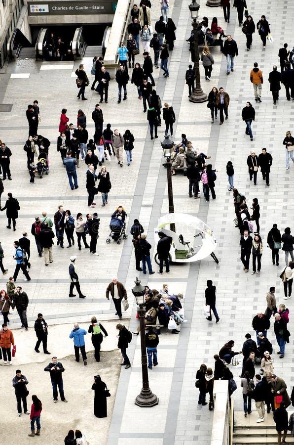 Folkmassa av folk på gatan royaltyfria foton