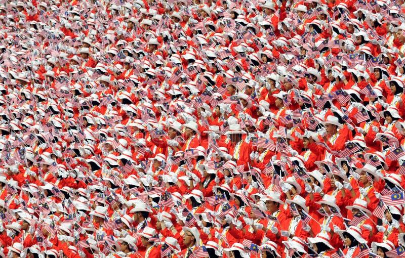 folkmassadagen självständiga malaysia ståtar s arkivfoto
