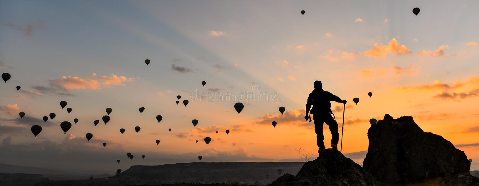Follow balloon flying to the summit. Summit success.Mountaineering activities.Peak and success concept and peace stock photos