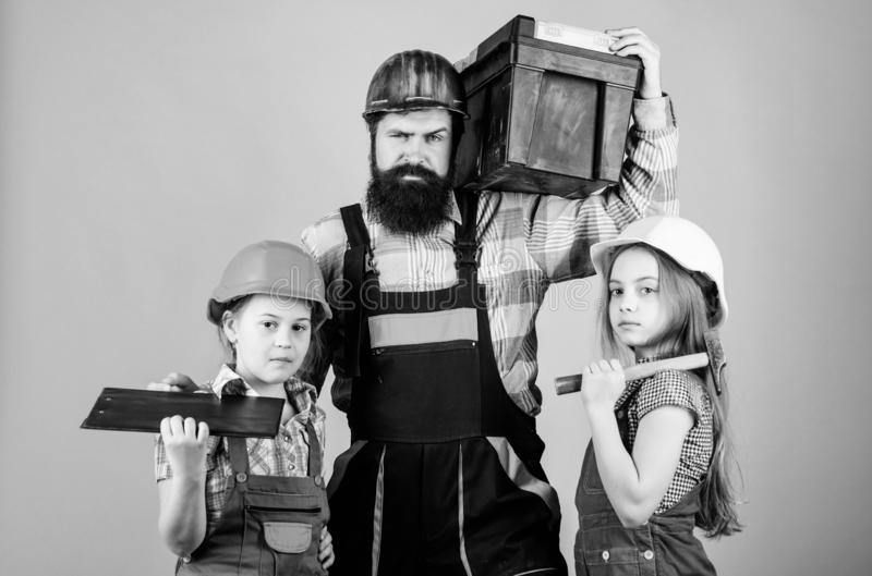 Follow father. Father builder kids girls. Teach daughter. Informal education. Fathers day. Sisters help father builder. Our dad has skillful fingers. Home royalty free stock photo