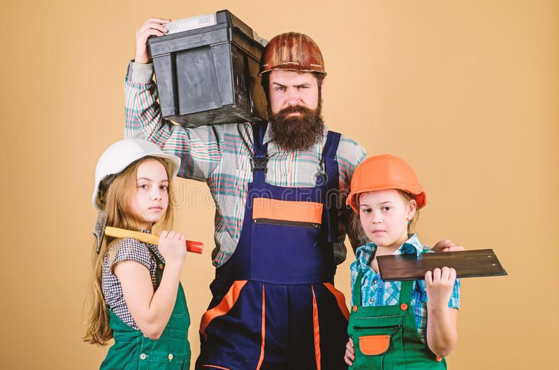 Follow father. Father builder kids girls. Teach daughter. Informal education. Fathers day. Sisters help father builder stock photo