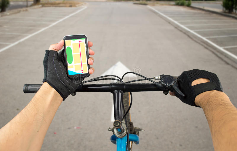 Follow gps coordinates in the city. View a map on the mobile phone on a city bike and search GPS coordinates stock images