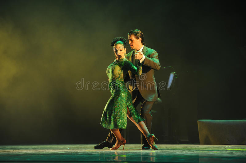 Follow others at every step-the identity of the mystery-Tango Dance Drama. Fernanda Ghi and Guillermo Merlo is Argentina's most famous tango dancer, is also a royalty free stock image