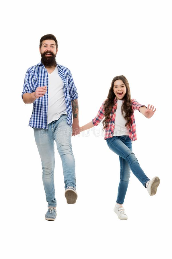 Following fathers example. On same wave concept. Bearded father and small child walking or running together. Move on. Lets move. Kid and dad cheerful friends royalty free stock image
