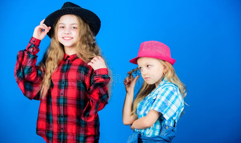 Following sister in everything. Cool cutie fashionable outfit. Happy childhood. Kids fashion concept. Check out our stock photo