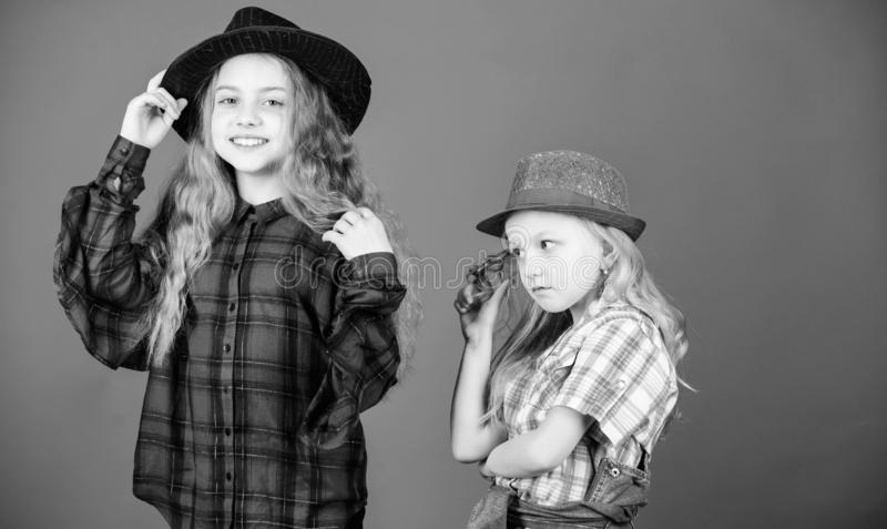 Following sister in everything. Cool cutie fashionable outfit. Happy childhood. Kids fashion concept. Check out our stock image