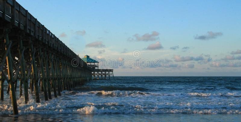 Folly Beach Pier in SC. A fishing pier at Folly Beach in South Carolina at the Tides Hotel royalty free stock photos