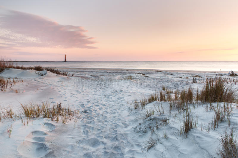 Folly Beach Sunrise Morris Island Lighthouse Charleston SC stock photos