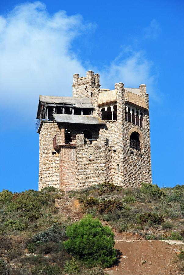 Folly on the hillside, Alhaurin El Grande. Folly in the countryside originally built as a water tower, Alhaurin El Grande, Costa del Sol, Andalusia, Spain royalty free stock images