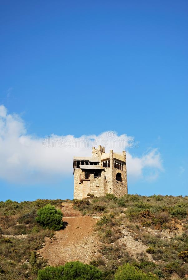 Folly on the hillside, Alhaurin El Grande. Folly in the countryside originally built as a water tower, Alhaurin El Grande, Costa del Sol, Andalusia, Spain stock photos