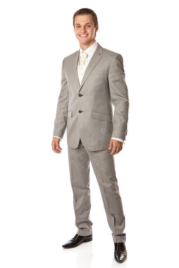 Folował długość młody człowiek w kostiumu uśmiechniętym brigh fotografia royalty free