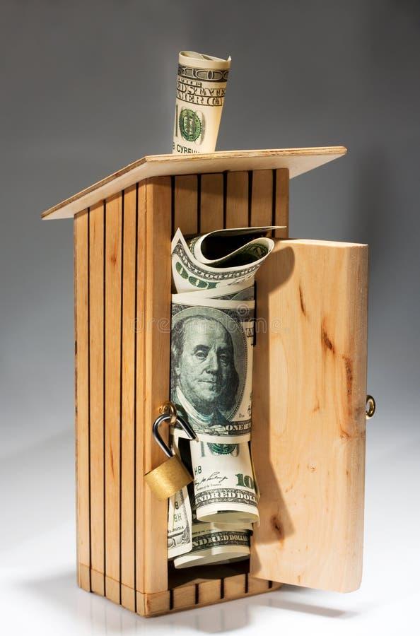 folował drewnianego pieniądze moneybox obraz stock