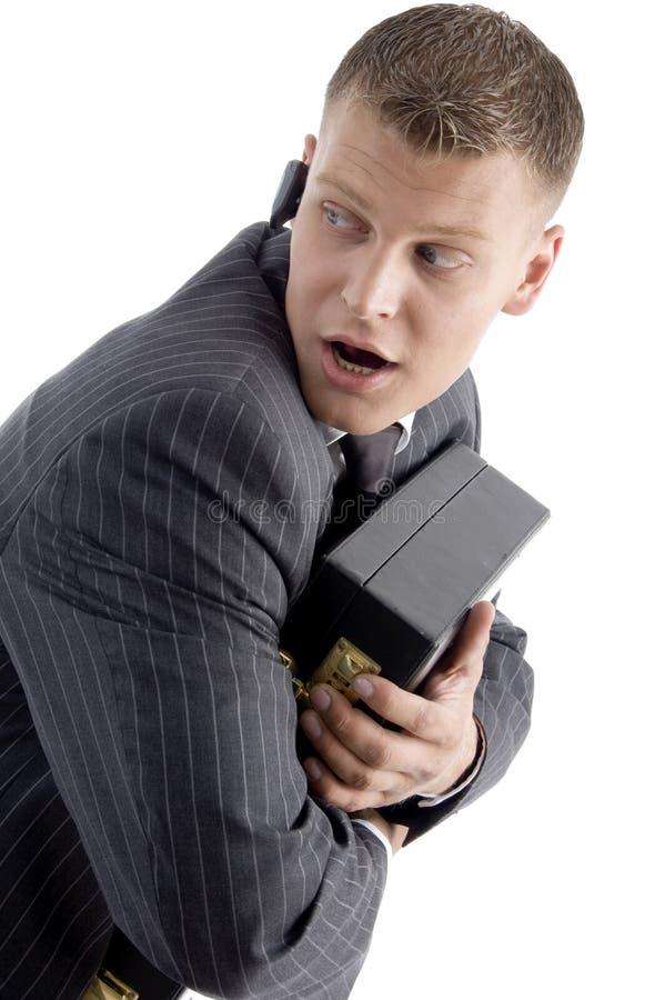 fonctionnement d'homme d'affaires effrayé photos stock