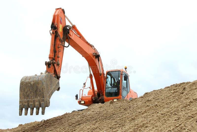 Fonctionnement de creusement de machine photographie stock libre de droits