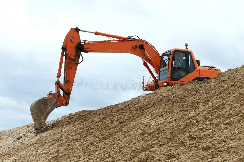 Fonctionnement de creusement de machine photos stock