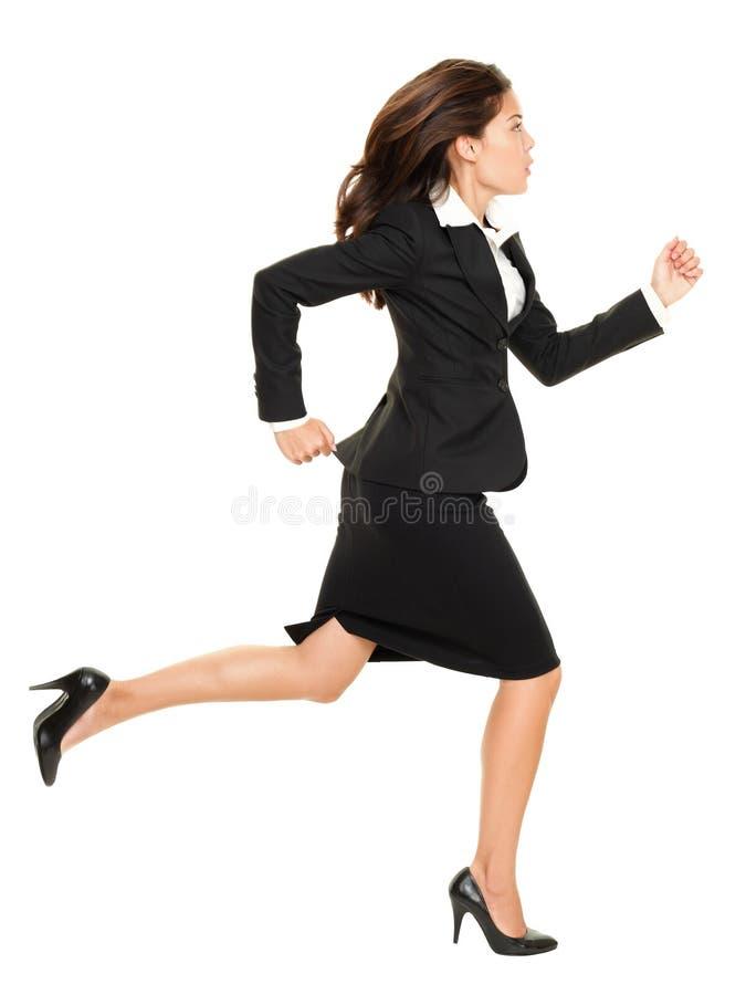 Fonctionnement de femme d'affaires image stock