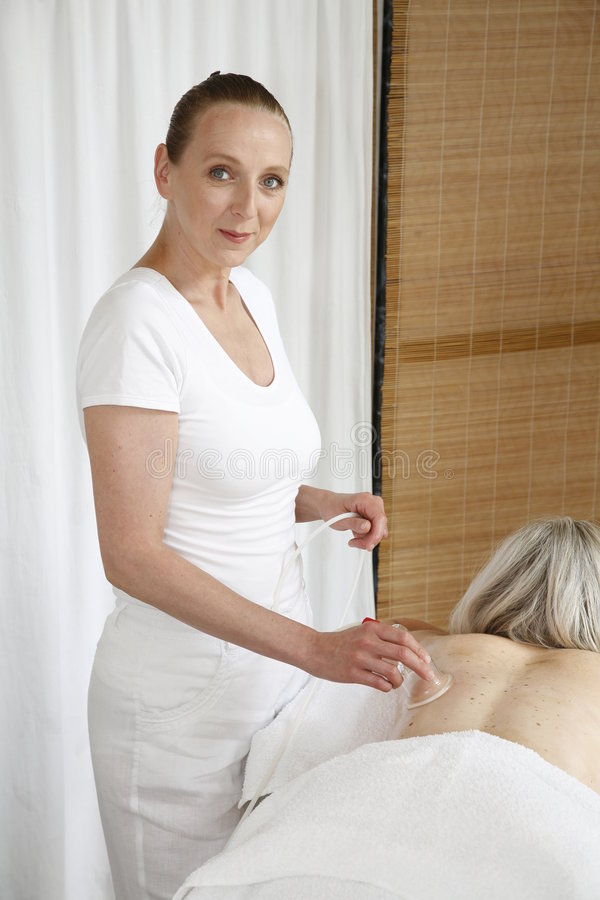 Fonctionnement de masseuse photo libre de droits