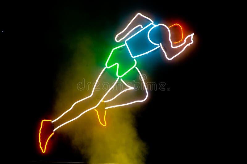 fonctionnement de néon d'athlète illustration de vecteur