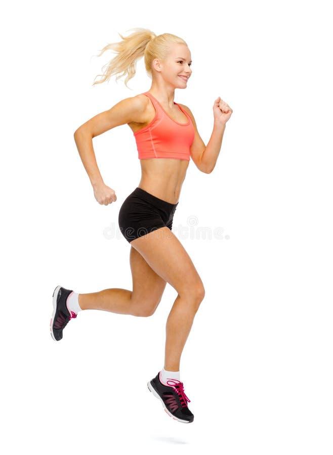 Fonctionnement ou sauter sportif de femme photographie stock libre de droits