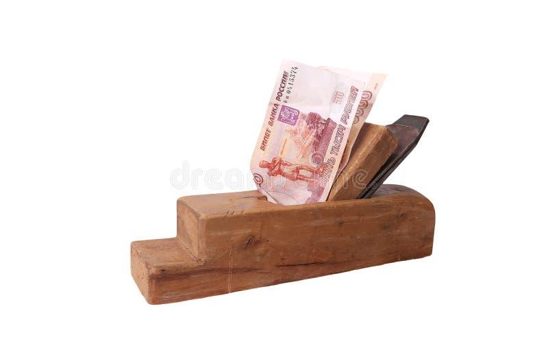 Fonctionnez et gagnez Vieux bois la planeuse et les billets de banque de rouble russe images stock