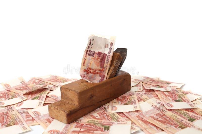 Fonctionnez et gagnez Vieux bois la planeuse et les billets de banque de rouble russe photographie stock