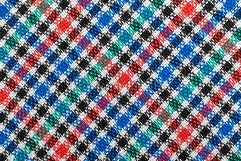Fond à carreaux diagonal de tissu de plaid Texture de tissu vert bleu rouge de plaid image stock