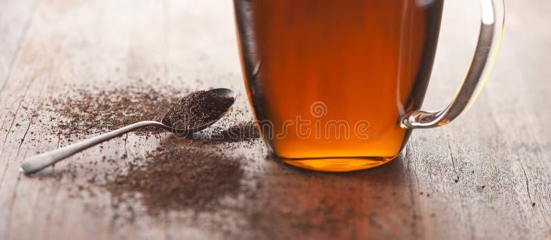 Fond à feuilles mobiles de thé images stock