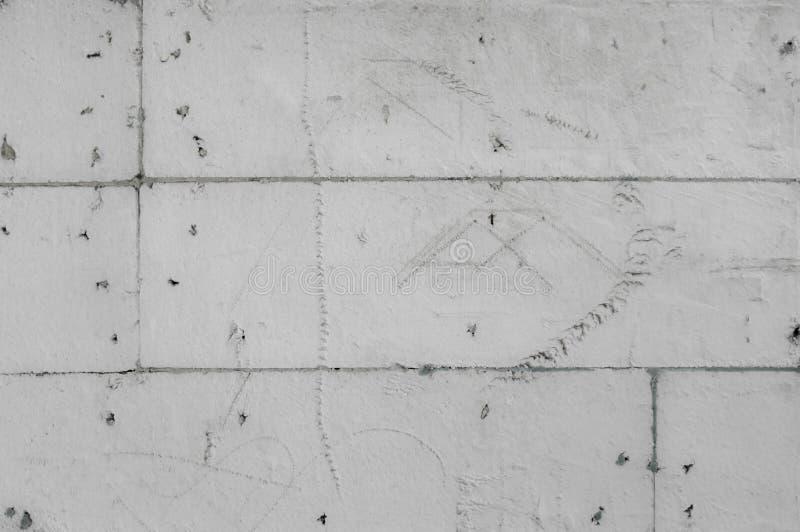 Fond à fond gris strident de mur de mousse de styrol avec des croquis photo libre de droits
