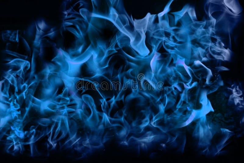 Fond abstrait conceptuel de texture du feu de flamme bleue photographie stock