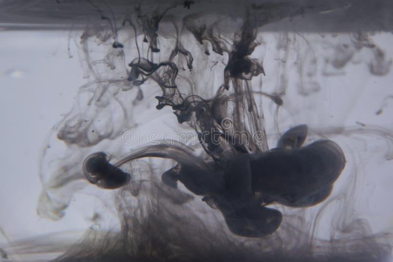 Fond abstrait d'encre dans l'eau images stock