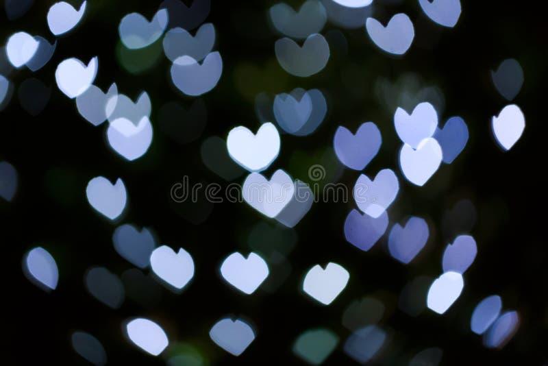 Fond abstrait de bokeh de lumière de forme de coeur de defocus image libre de droits