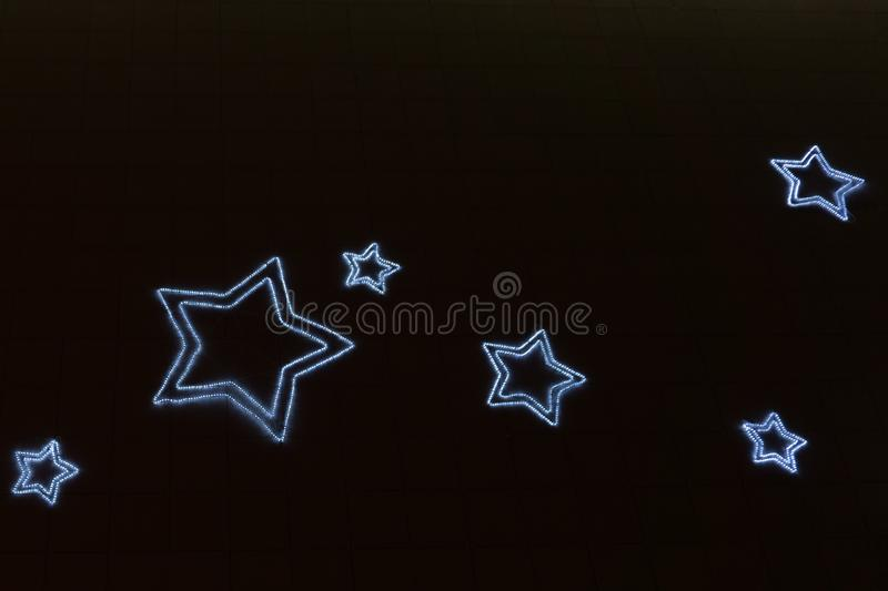 Fond abstrait de bokeh de forme d'étoile de lumière image stock