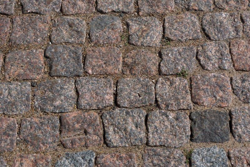 Fond abstrait de vieille texture de trottoir de pavé rond avec la vue naturelle de modèles d'en haut images stock