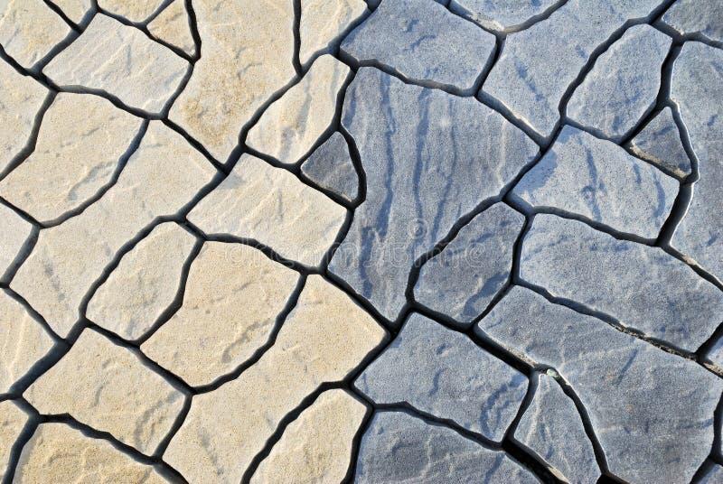 Fond abstrait pavant se composant des pierres irrégulières photographie stock libre de droits
