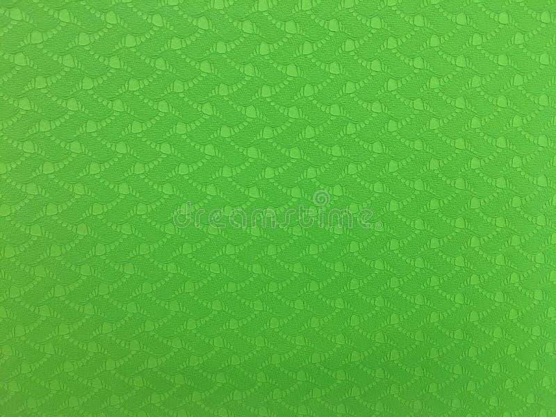 Fond approximatif de texture de modèle de tapis vert de yoga photos stock