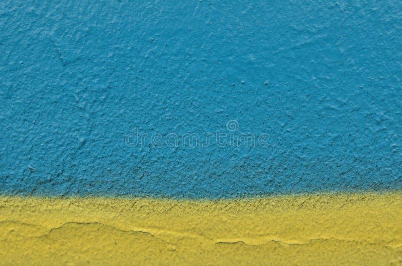 Fond approximatif jaune bleu de texture de peinture de jet photos stock