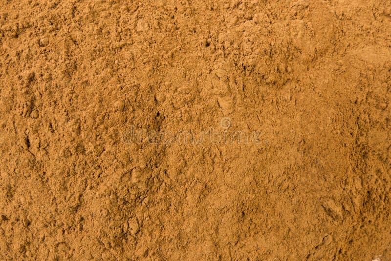 Fond au sol ou fraisé de cannelle Texture de assaisonnement naturelle Épices et ingrédients de nourriture naturels photos stock