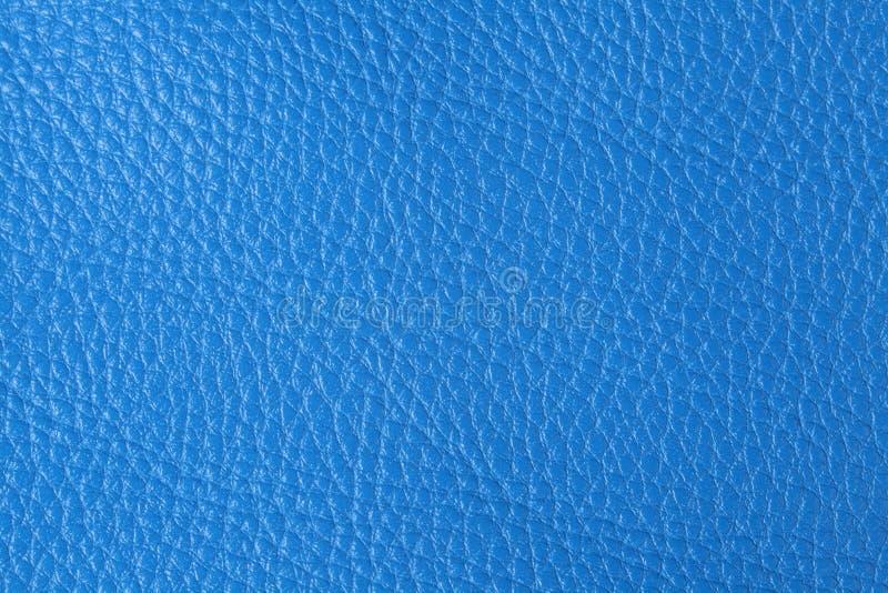 Fond avec la texture du cuir bleu photographie stock libre de droits