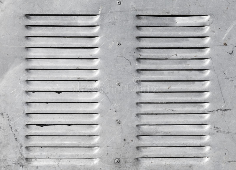 Fond avec le gril brillant de ventilation en métal photo stock